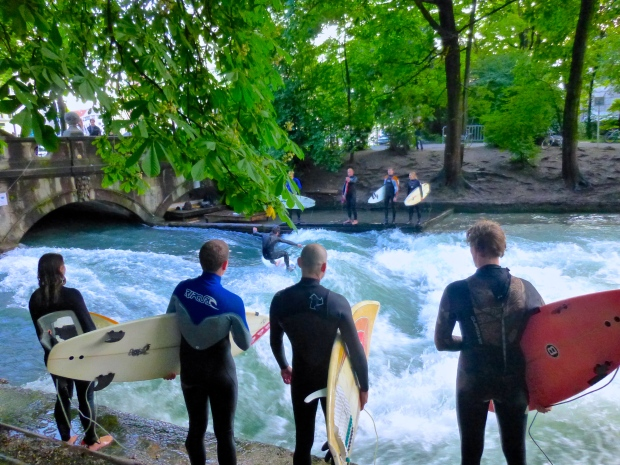 Surfers on the Eisbach River in Munich, Germany